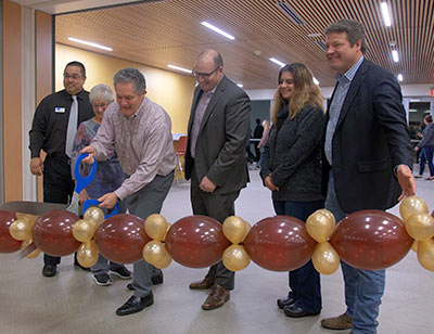 Ribbon cutting ceremony, link to Enumclaw High School Addition is Open article