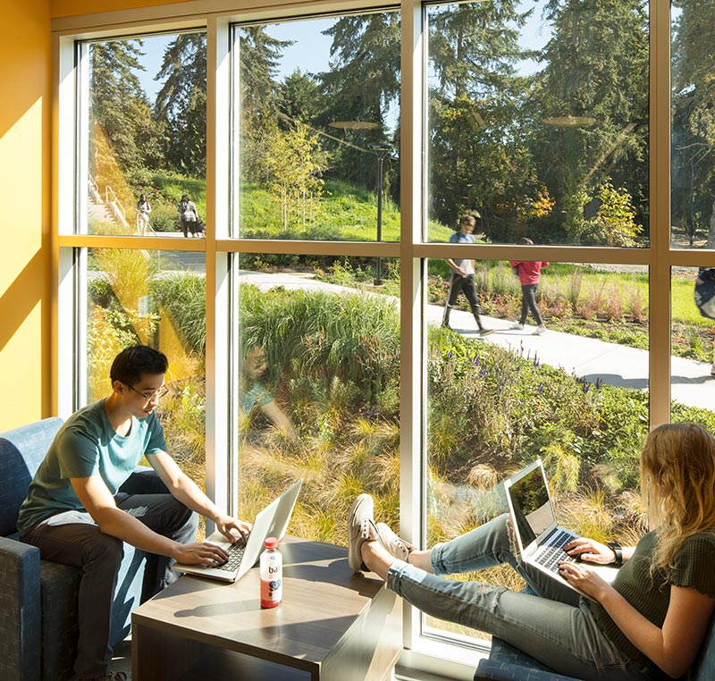 Bellevue College students in study area with large windows at new Residence Hall, link to project information