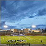 building exterior, eving, football players on field, link to larger image